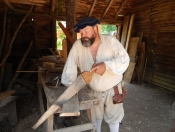 Colonial Man with Saw