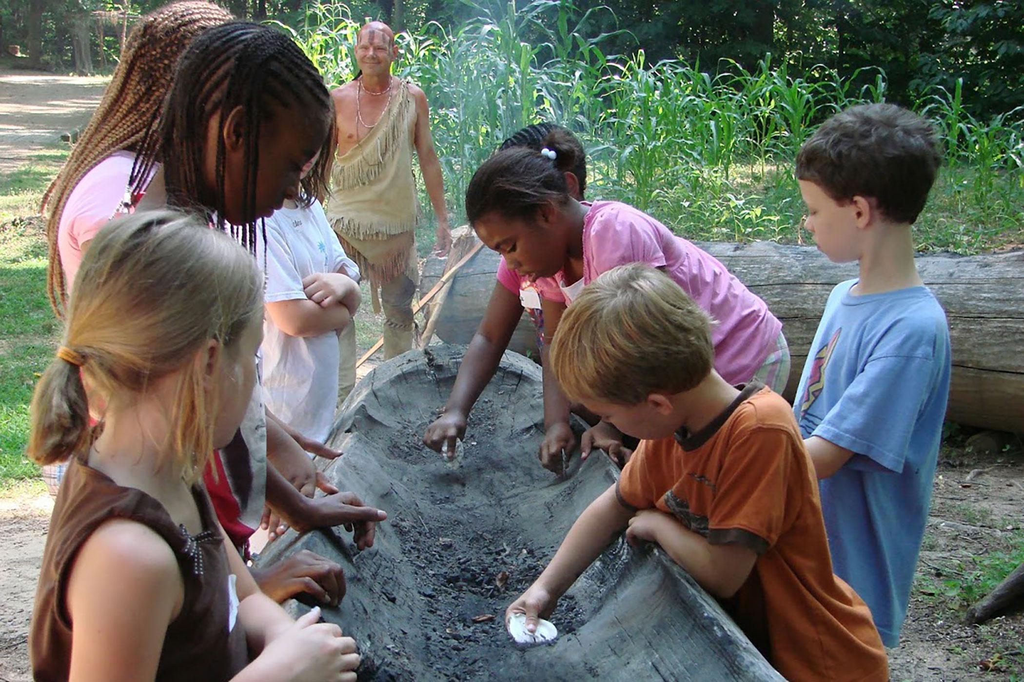 Kids Digging Canoe