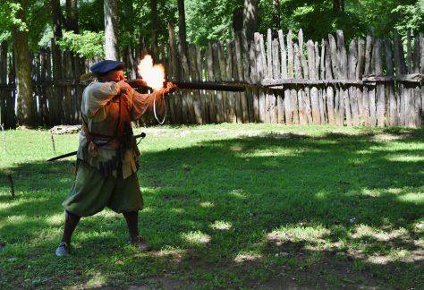 Interpreter Firing a Musket