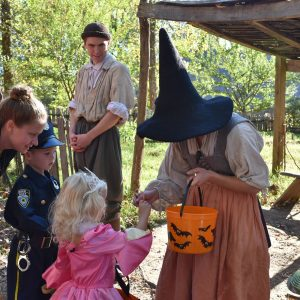 Kids trick-or-treating through historic site