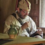Colonial man sewing