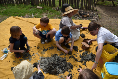 Archaeology Camp Kids Sifting Through Dirt
