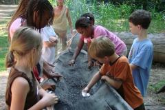 Kids Scraping Canoe